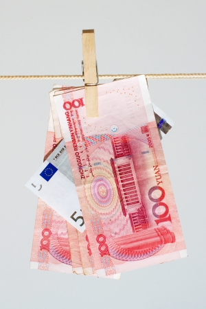 Several hundred Chinese yuan banknotes absorbs five euros Stock Photo - 15013090
