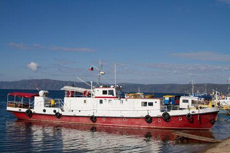 Small ship at the pier in Listvyanka on Lake Baikal Stock Photo - 15429444