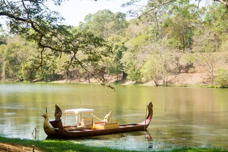 Small stroller Cambodian boat near the shore