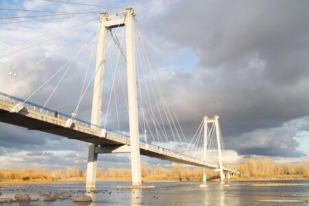 A pedestrian suspension bridge to the island Tatysheva across the Yenisei River in Krasnoyarsk