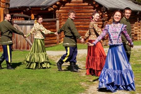 National Ensemble of young guys and beautiful girls dancing the Russian dance photo