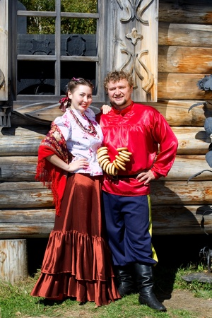 A young boy and a beautiful Russian girl in national costumes photo