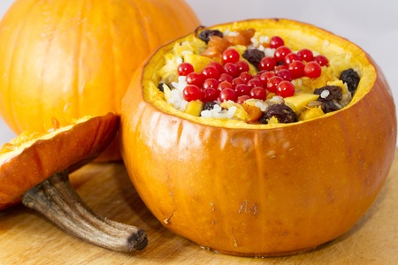Baked pumpkin stuffed with rice, dried apricots, raisins and banana