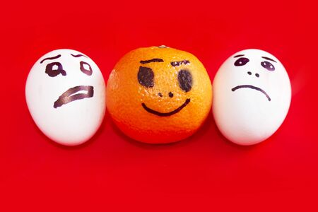 studio happy overall: Happy face painted on tangerine and a sad face on eggs