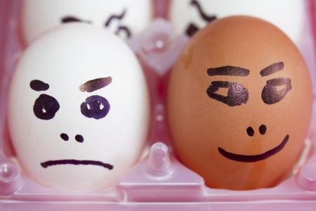 Happy and angry eggs Stock Photo