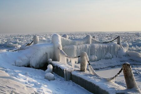 Iced small dock on Lake Baikal in winter photo
