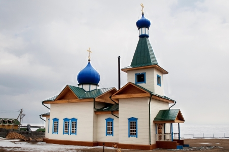 Small wooden church in the village of Great Goloustnoye in Irkutsk region Stock Photo - 17419519