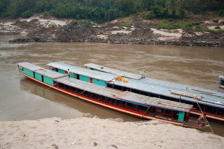 Two large boats near the pier on the Mekong River Stock Photo - 18494437