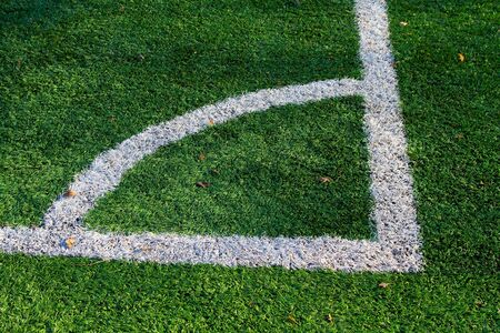 Green artificial turf football and markings near the corner flag