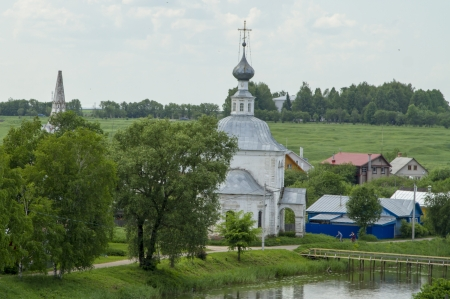 View of the Orthodox church and the bell tower in the town of Suzdal photo