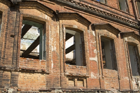 caved: The old abandoned brick building on the bank of the Oka River Stock Photo