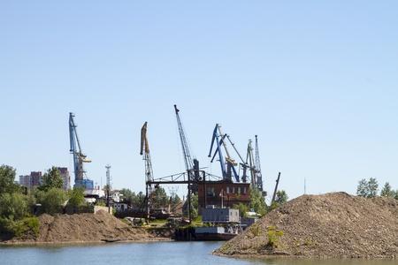 Crane loading cargo in the river port city of Irkutsk Stock Photo - 20944951