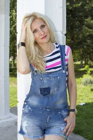 Beautiful girl in denim overalls photo
