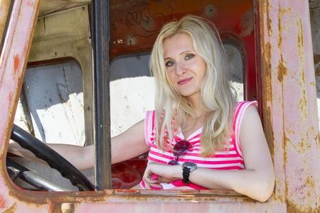 Glamour pretty girl driving a broken truck