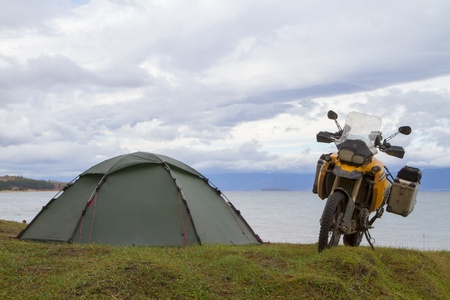 Tent and motorcycle traveler on the shores of Lake Baikal photo