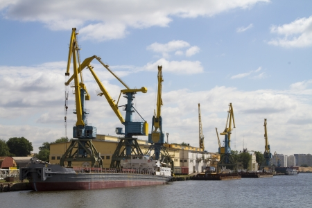 Crane loading cargo in the river port city of Moscow Stock Photo - 22397050