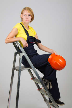 Beautiful sexy girl sitting on a stepladder Stock Photo