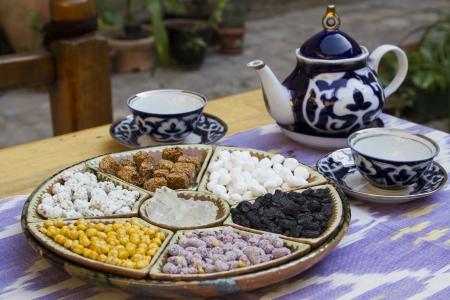 uzbek: Traditional Uzbek hospitality - is served tea and sweets Stock Photo