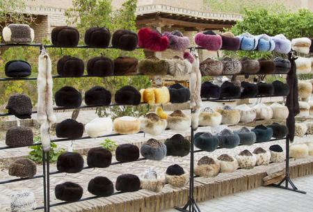 peltry: Sales of fur hats in the bazaar in the city of Khiva, Uzbekistan