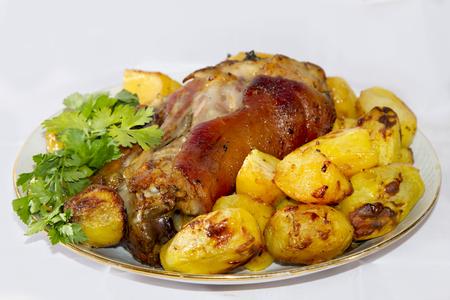 shin bone: Baked pork shank with potatoes and parsley