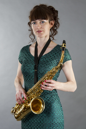 Beautiful young girl with saxophone Stock Photo - 27352306