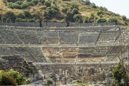 fertility goddess: Tourists on the benches and the stage of the ancient theater in Ephesus