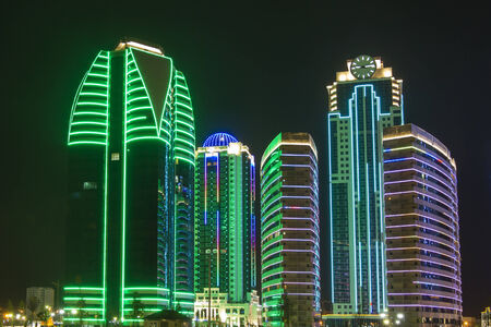 Buildings in the district of Grozny City with night illumination photo