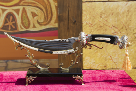 damascus: GROZNY, RUSSIA - SEPTEMBER 7: Dagestan dagger made by craftsmen of Damascus steel at the exhibition on September 07, 2014 in Grozny.