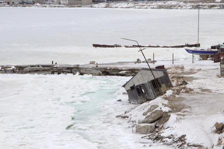 barracks: MAGADAN, RUSSIA - DECEMBER 22: Old Soviet barracks on the shores of the Sea of Okhotsk in Magadan on December 22, 2014 in Magadan.