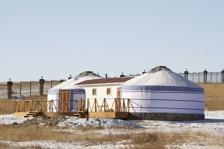 well maintained: Yurts in the tourist camp in Mongolia in winter Stock Photo