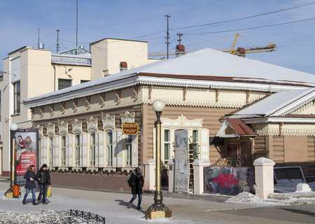 ulan ude: ULAN-UDE, RUSSIA - FEBRUARY 4: Wooden houses on the street in the capital of the Republic of Buryatia on Fevruary 4, 2015 in Ulan-Ude.