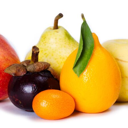 Several different fruits on white background photo