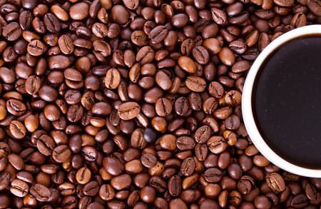 Cup of coffee on a background coffee beans photo