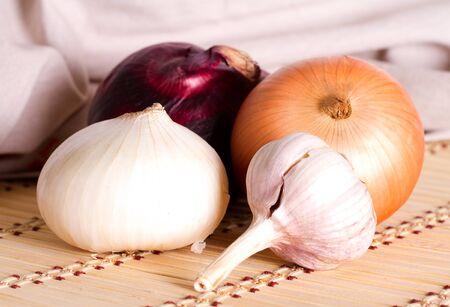 clove: Multicolored onion and clove garlic Stock Photo