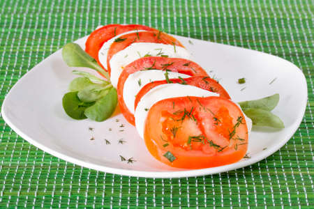 Traditional Caprese salad with mozzarella and fresh tomatoes