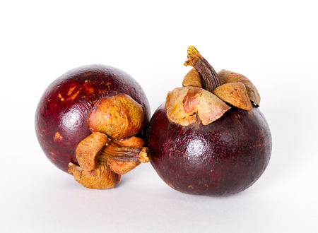 Several mangosteen on the white background Stock Photo