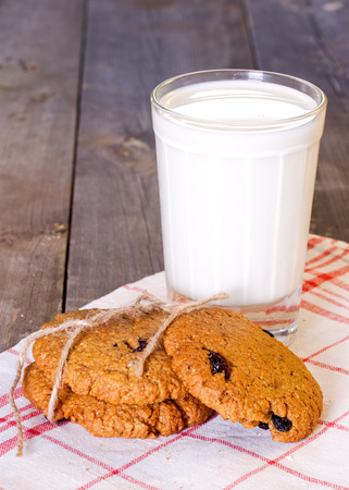 Oatmeal cookies with raisins and a glass of milk photo