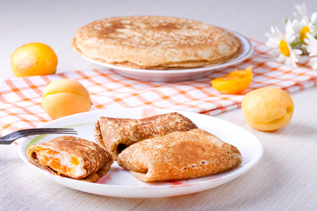 Pancakes with curd cheese and dried apricots