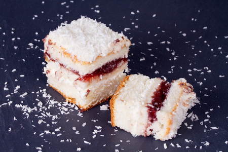 jam tarts: Cake with sprinkles of coconut and mint leaves