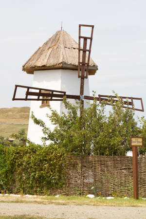taman: TAMAN, RUSSIA - AUGUST 12: Windmill in the ethnographic village Ataman on August 12, 2015 in Taman. Editorial