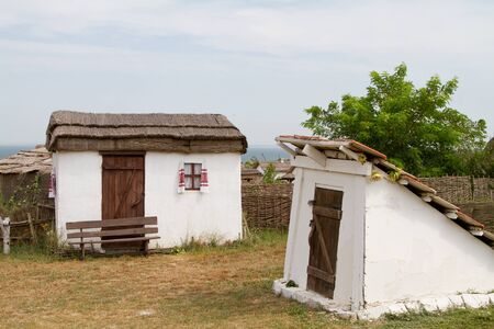 daub: TAMAN, RUSSIA - AUGUST 12: Old wattle and daub hut and a cellar in the ethnographic village Ataman on August 12, 2015 in Taman. Editorial