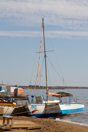 approached: YAROVOYE, RUSSIA - SEPTEMBER 1: Sailing catamaran on the shore of a salt lake Bolschoe Yarovoye on September 1, 2015 in Yarovoye. Editorial