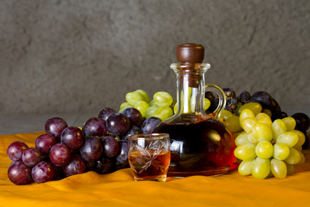 decanter: Decanter of brandy and grape Stock Photo
