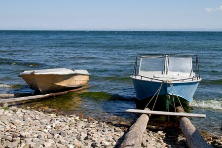crone: Boats on the shore of Lake Baikal on a sunny day