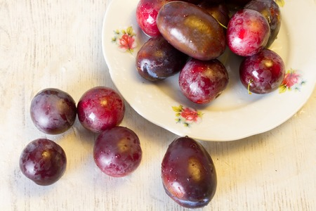 plum: Ripe plums and cherry-plum on a white table Stock Photo
