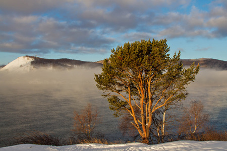 insipid: Vapor on the Angara River and Lake Baikal at dawn frosty morning