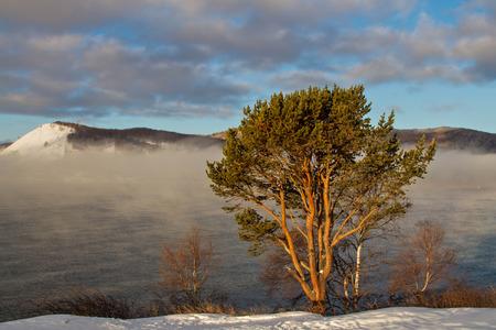 insipid: Vapor on the Angara River and Lake Baikal at dawn frosty morning
