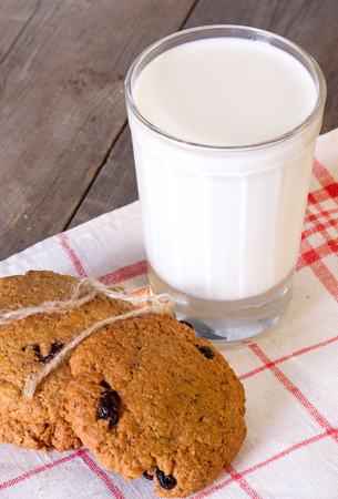 oatmeal cookies: Oatmeal cookies with raisins and a glass of milk
