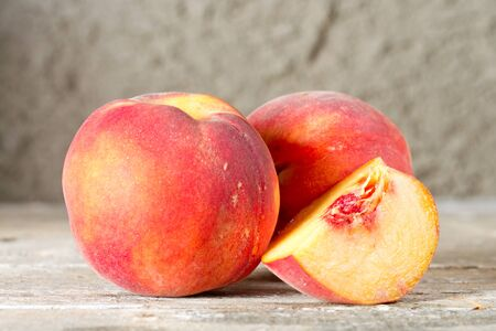 velvety: The ripe whole and sliced peaches