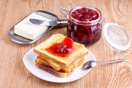 strawberry jam sandwich: Toast with strawberry jam and butter
